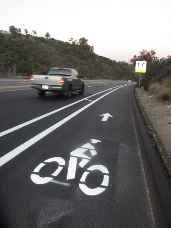 New bike lanes on the north side of Montezuma Road. Photo by Robert Craddick