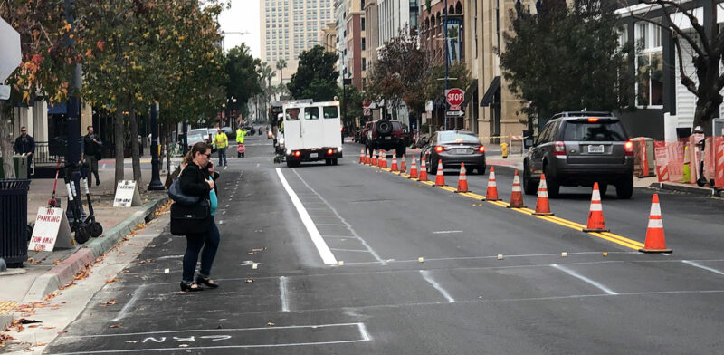 The first stripes of the Downtown Mobility Plan are laid on J Street, December 2018