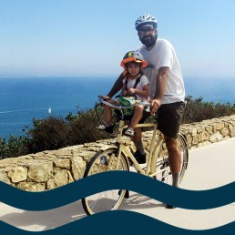 Esteban del Rio and child on bike in San Diego County
