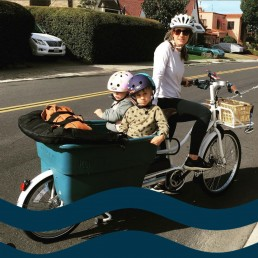 Mission Hills bike family showing mom with two kids in her cargo bike.