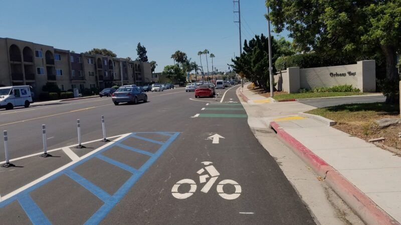 Looking west down W. Point Loma Blvd towards Adrian St.